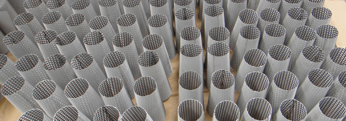 Sintered metal mesh filters supported by perforated tubes.