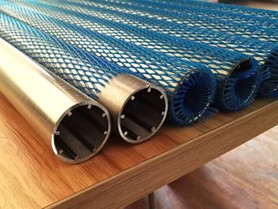 There are some wedge wire filters on the table, some of them are wrapped by blue plastic film.