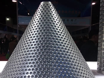 Sintered stainless steel cone filter overlaid by perforated cone